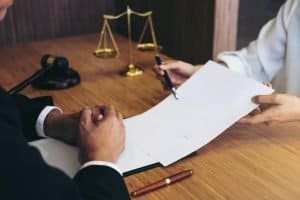 Consultation between a male lawyer and business people customer